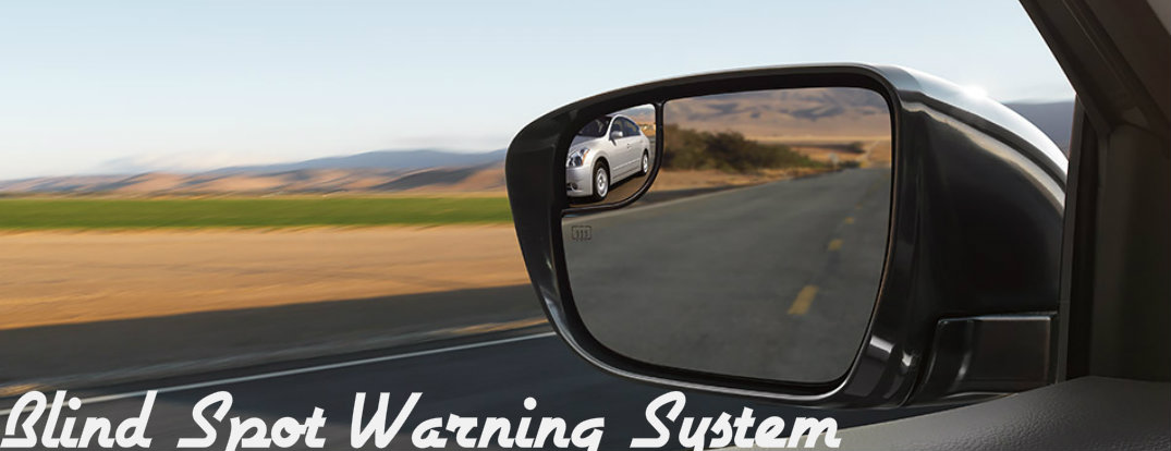 How do I turn Blind Spot Warning on and off in my Nissan Rogue?