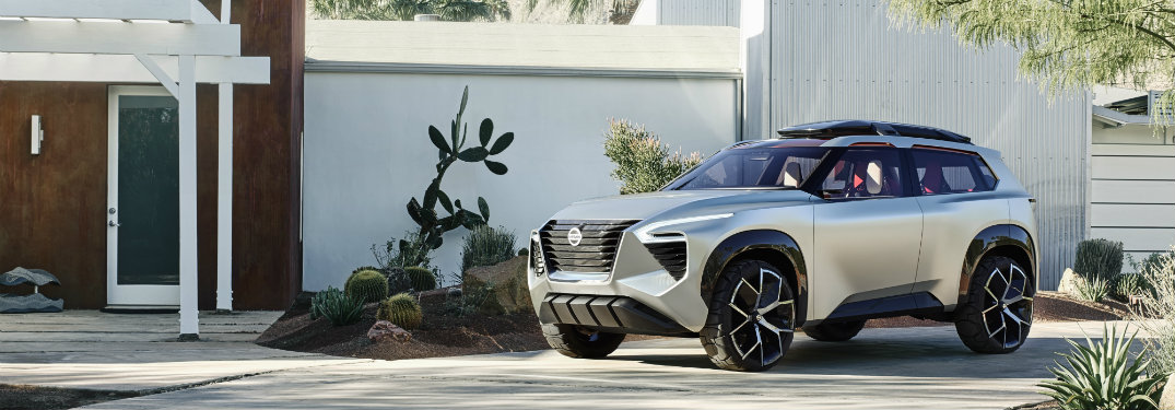 Nissan Xmotion concept parked by white building
