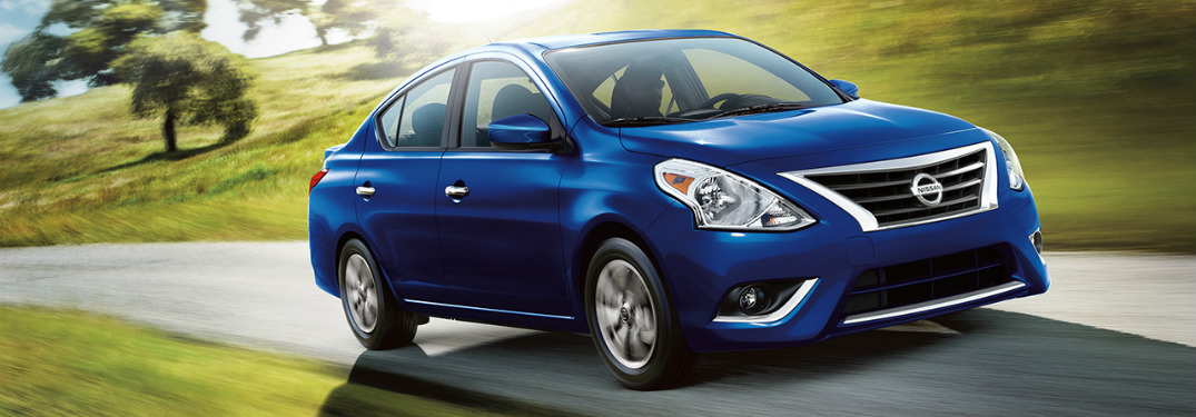 Blue 2018 Nissan Versa driving down open road