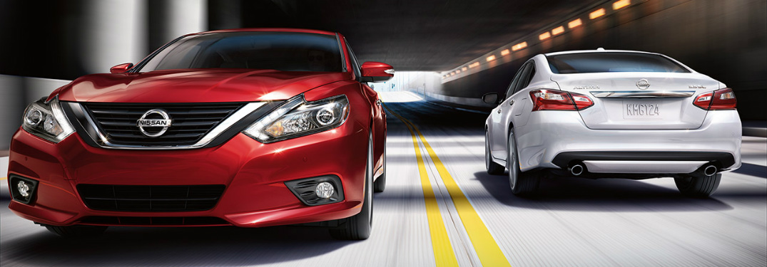 Red and white 2018 Nissan Altima models driving by each other