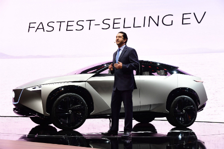 Man standing in front of the new Nissan IMx KURO concept