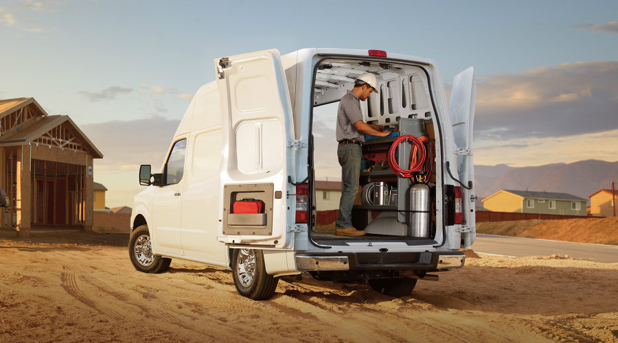 Man working in the back of the 2018 Nissan NV Cargo
