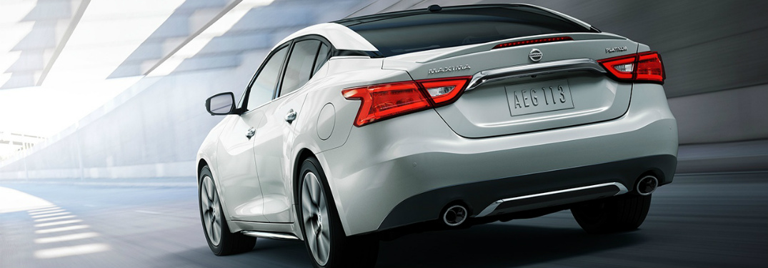 Rear view of a white 2018 Nissan Maxima driving through a tunnel