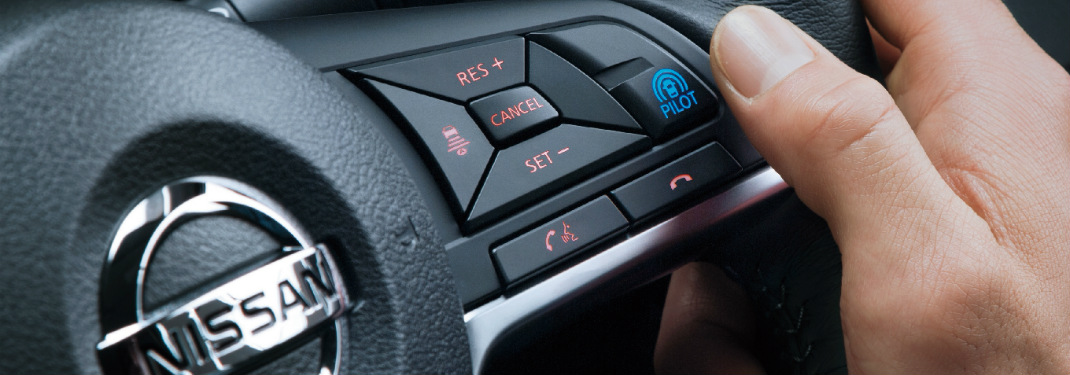 Driver pressing the ProPILOT Assist button in their Nissan vehicle