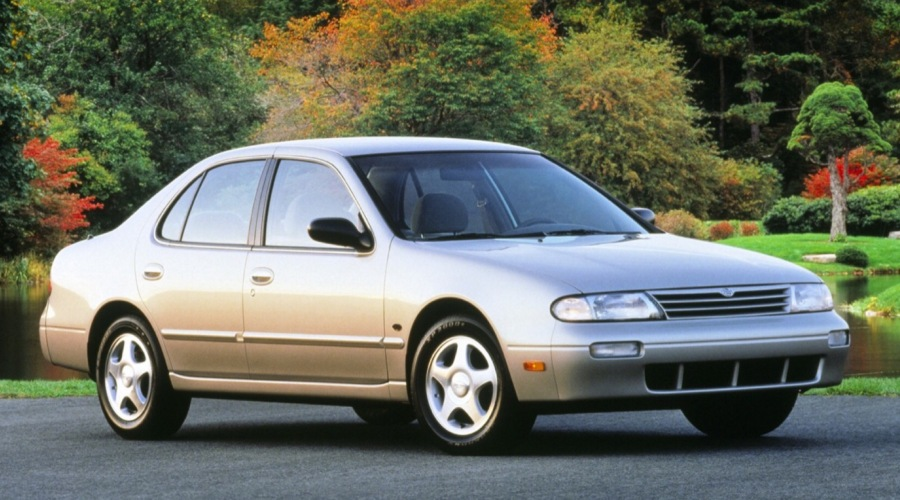 Tan first-generation Nissan Altima