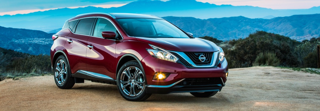 Side view of a red 2018 Nissan Murano on a cliff
