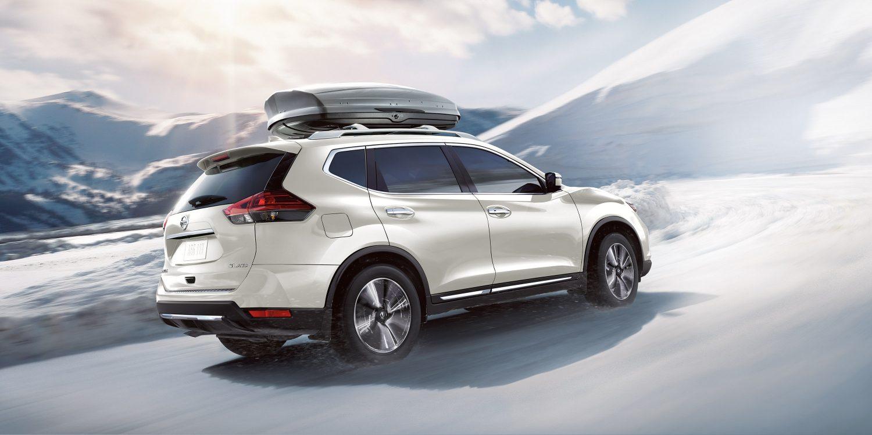 White 2018 Nissan Rogue driving through snow