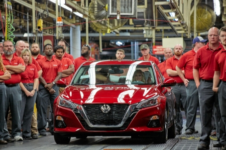 Nissan workers next to the 2019 Nissan Altima