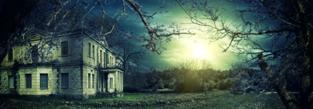 Spooky house at night by a full moon
