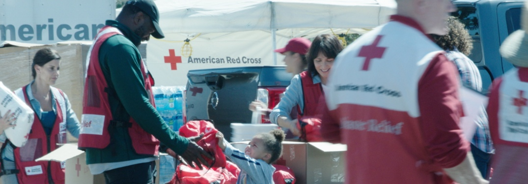 People of the American Red Cross gathering supplies