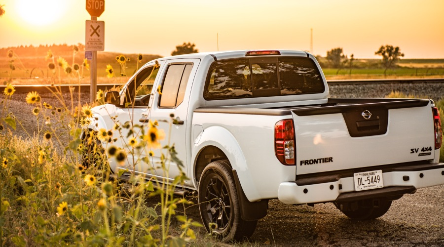 2019 Nissan Frontier parked next to flowers