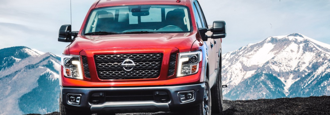 Red 2019 Nissan TITAN driving in the mountains