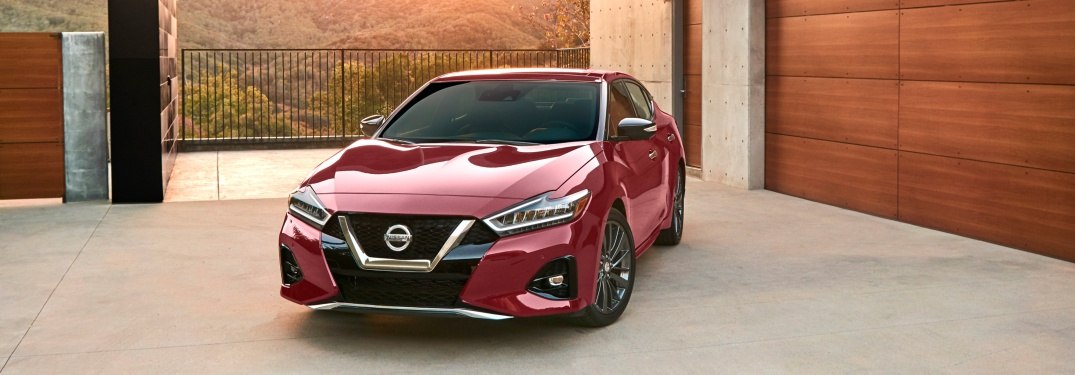 Red 2019 Nissan Maxima parked outside home
