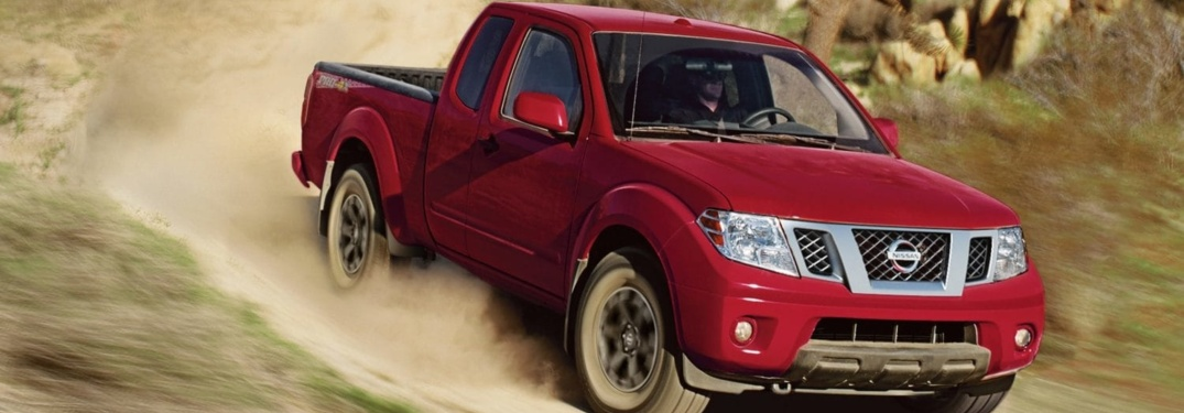Red 2019 Nissan Frontier driving off-road