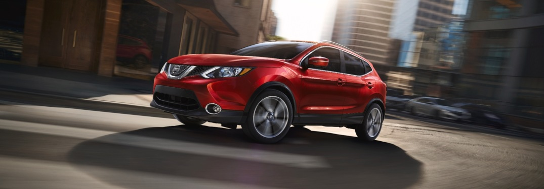 Red 2019 Nissan Rogue Sport rounding a corner