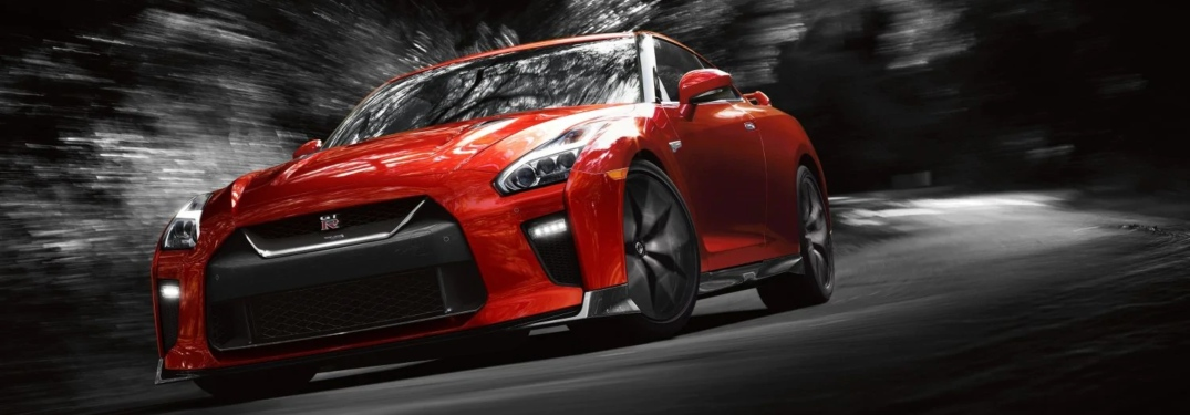 Red 2019 Nissan GT-R making a right turn