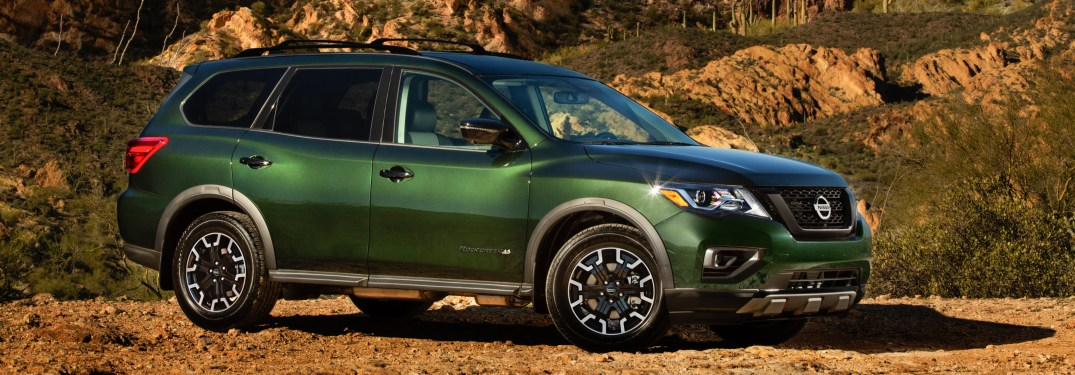 Side view of a green 2019 Nissan Pathfinder with the Rock Creek Edition Package