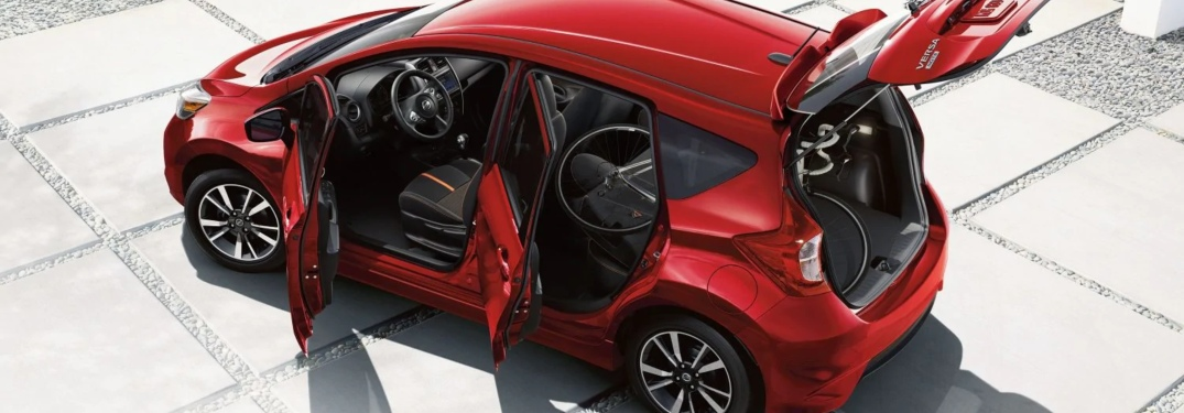 Overhead view of a red 2019 Nissan Versa Note with its doors open
