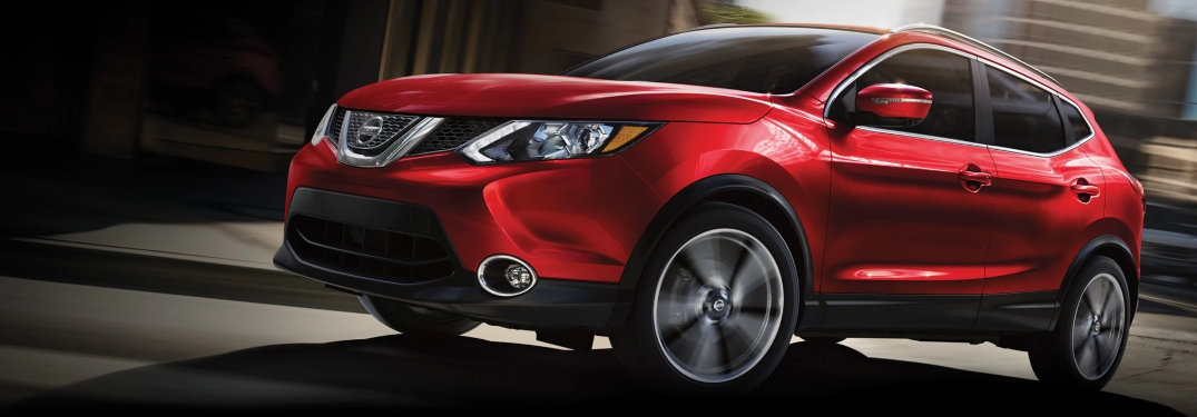 Side view of a red 2019 Nissan Rogue Sport