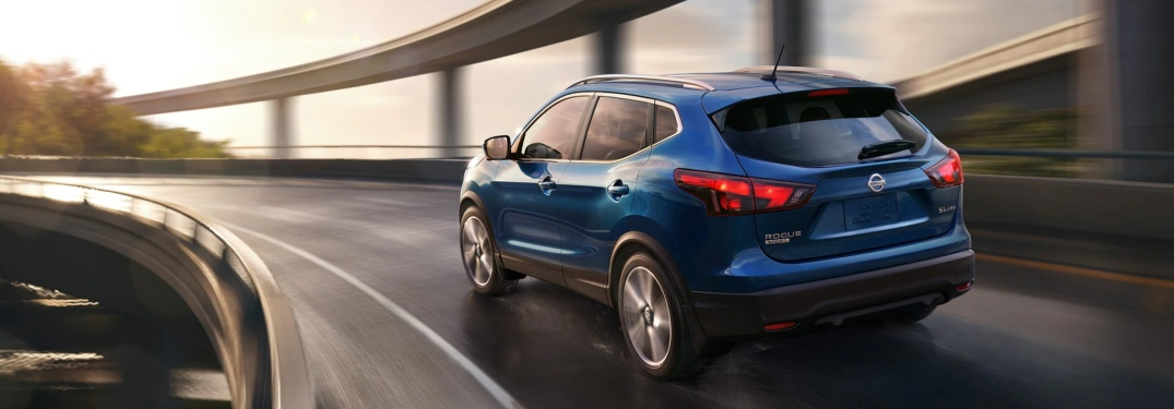 Blue 2019 Nissan Rogue Sport driving on a highway ramp