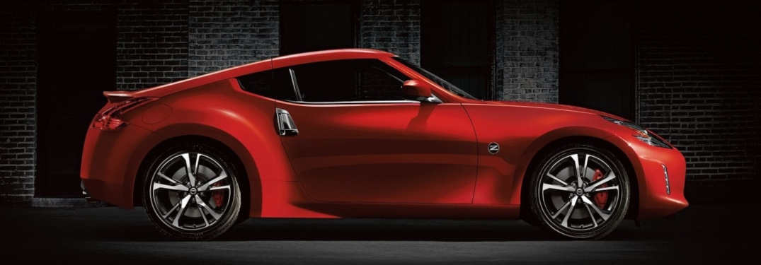 Side view of a red 2020 Nissan 370Z on a black background