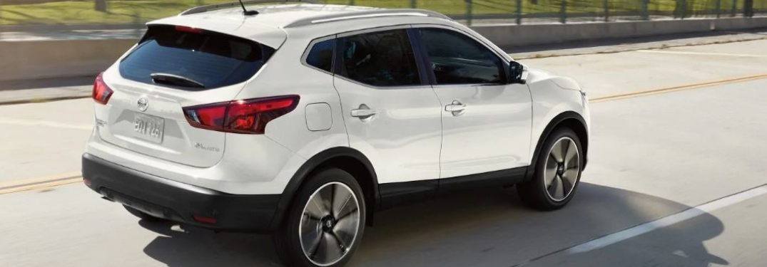 White 2019 Nissan Rogue Sport driving on open road