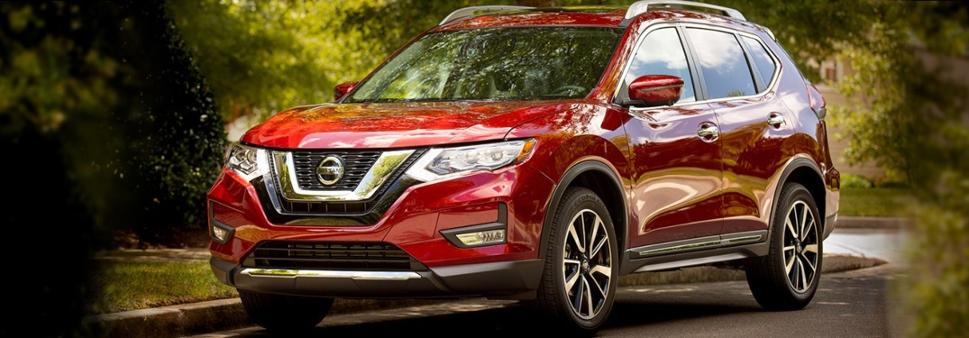 Side view of a red 2019 Nissan Rogue on a sunny day