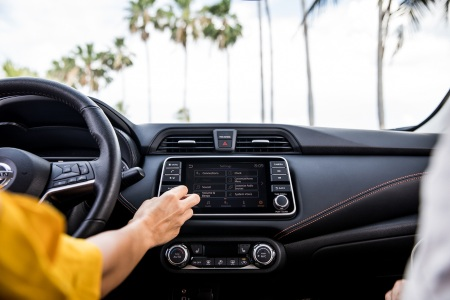 Woman using the infotainment system in the 2020 Nissan Versa