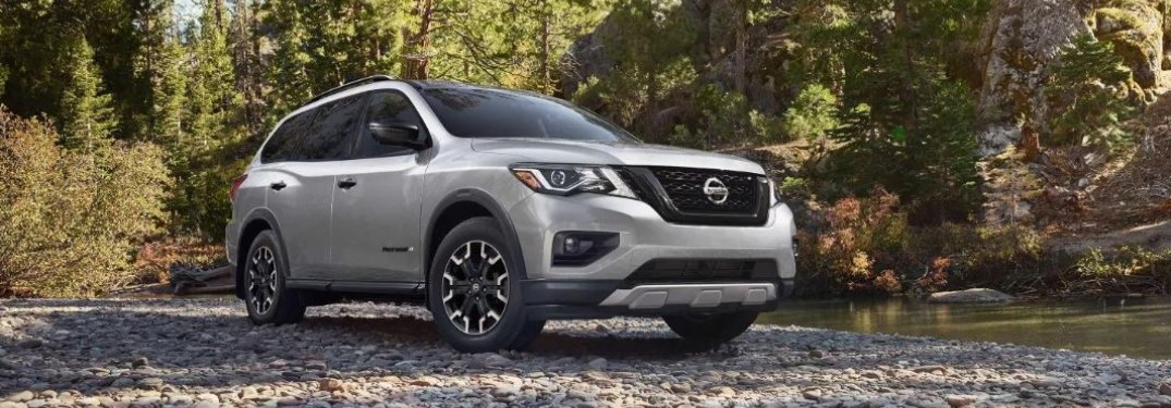 Silver 2019 Nissan Pathfinder parked on stone road