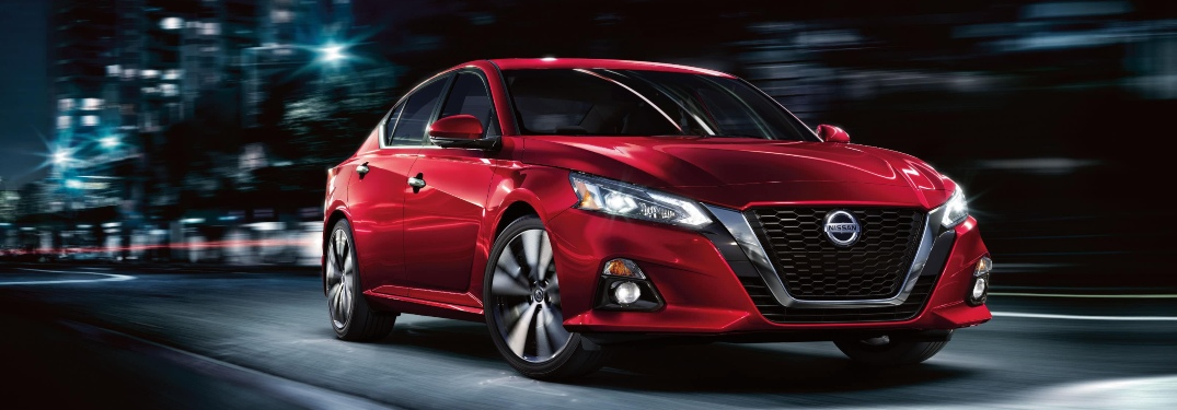 Red 2020 Nissan Altima driving at night