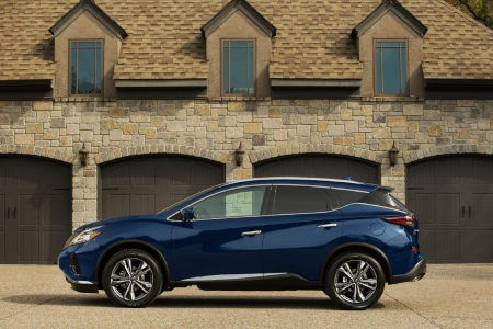 Side view of a blue 2019 Nissan Murano in front of building