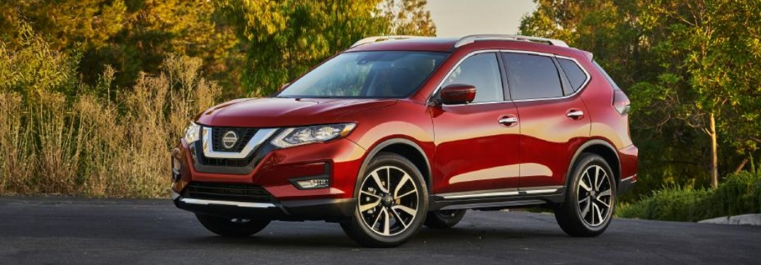 Side view of a red 2020 Nissan Rogue