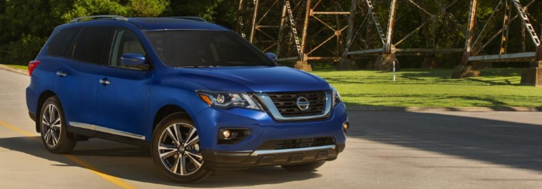 Side view of a blue 2020 Nissan Pathfinder