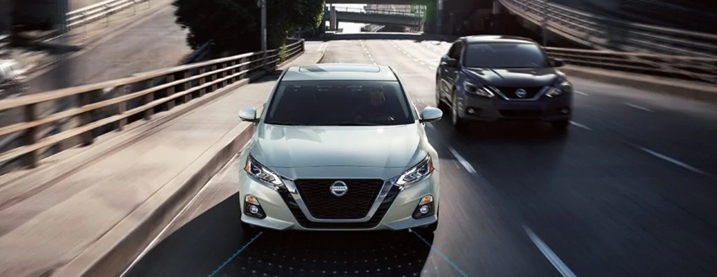 Front view of Nissan Altima models driving on highway