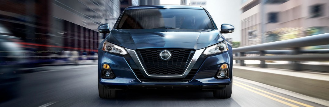 front of blue 2020 Nissan Altima