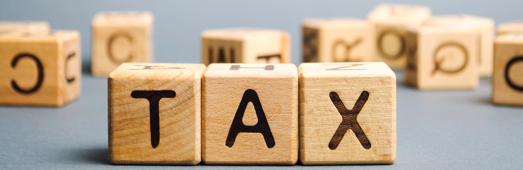 wooden blocks saying tax