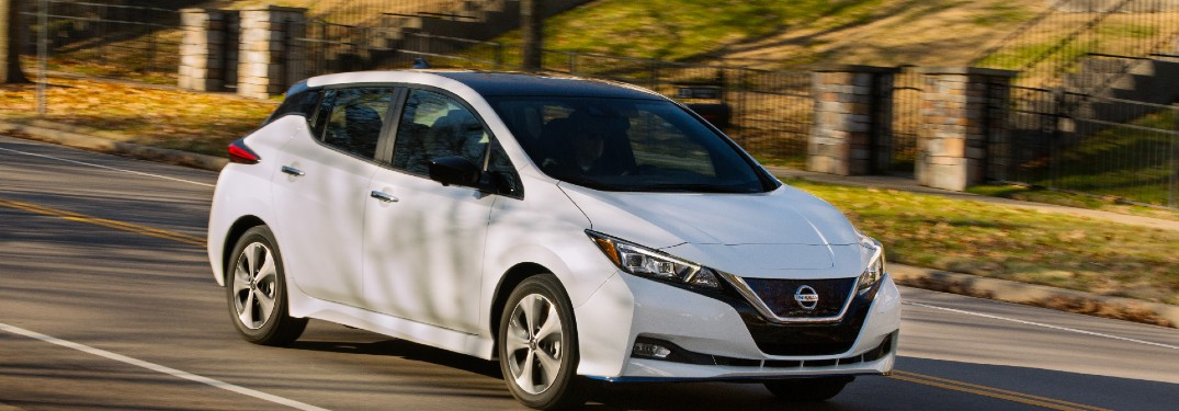 white 2020 Nissan Leaf driving on road