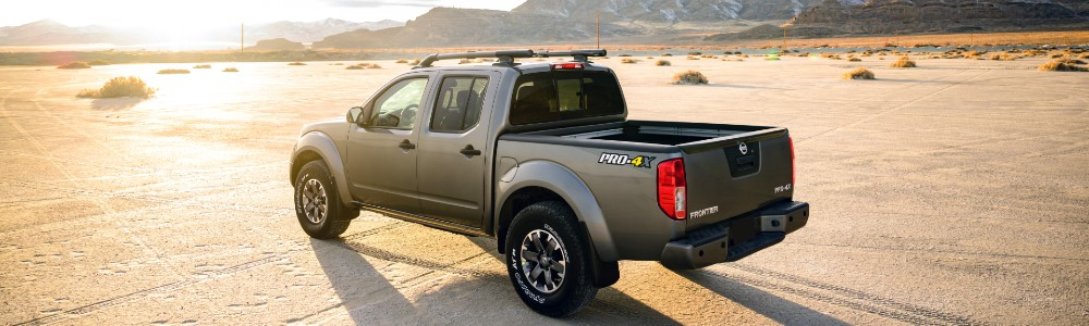 2020 Nissan Frontier driving into the sunset