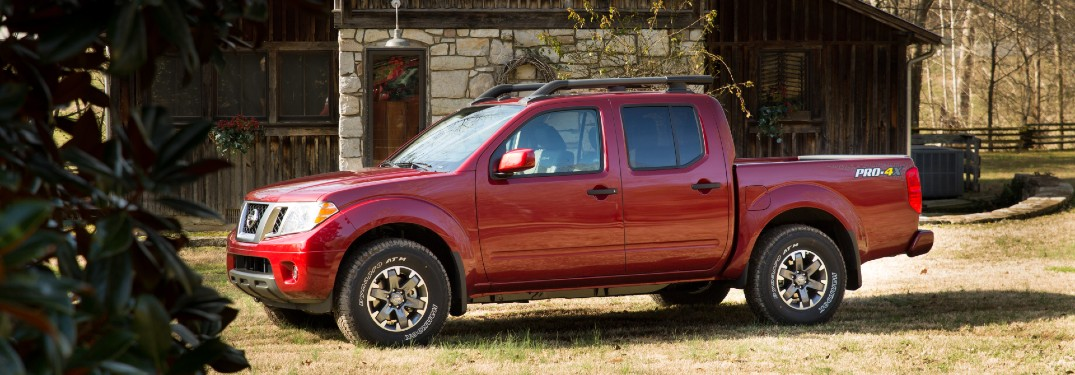side view of red nissan frontier