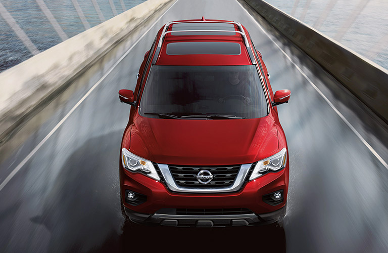 red 2020 Nissan Pathfinder driving on a bridge