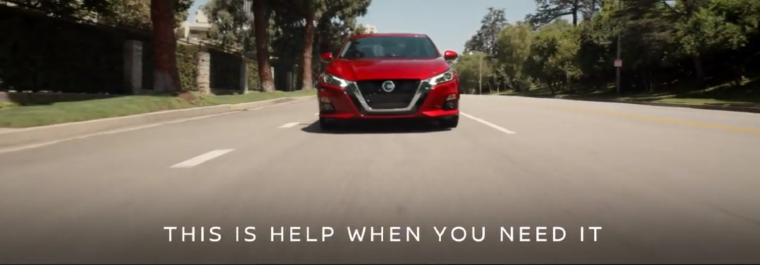 "front of red nissan car with text overlaying saying ""this is help when you need it"""