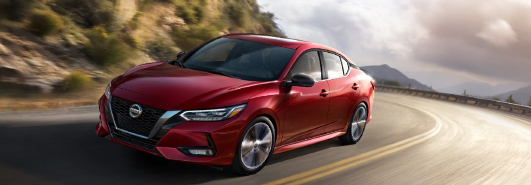 red 2020 Nissan Sentra driving around curve
