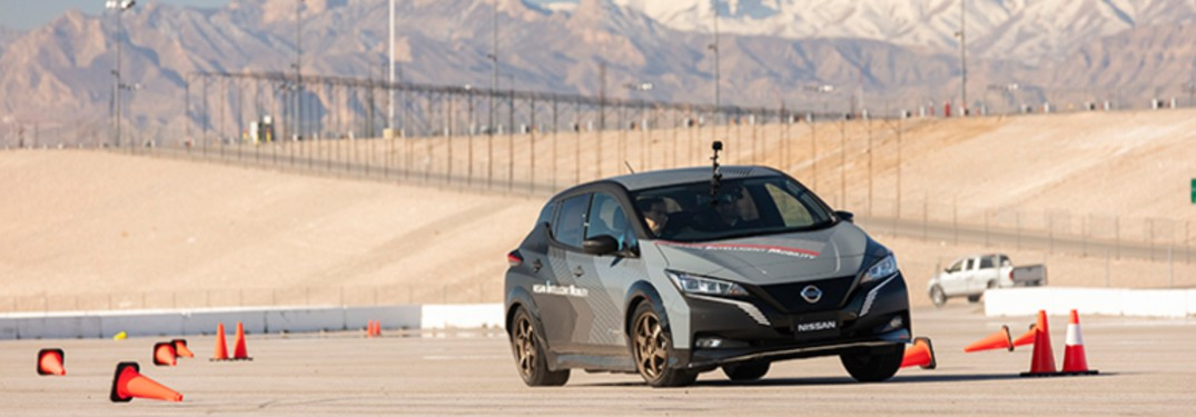 vehicle with Nissan's e-4ORCE technology driving on course