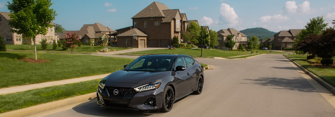 2021 Nissan Maxima with houses in the background
