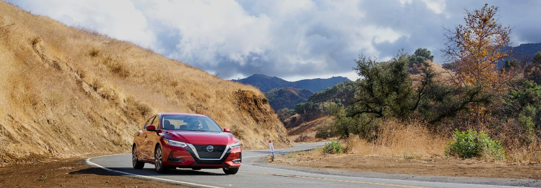 2021 Nissan Sentra driving around curve