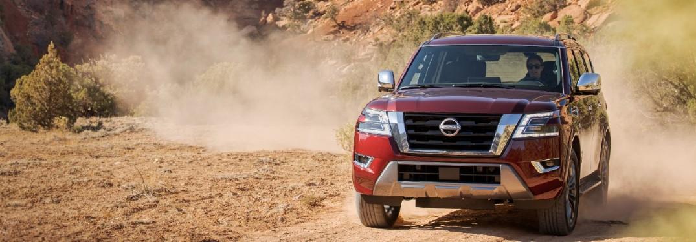 2021 Nissan Armada driving through dirt