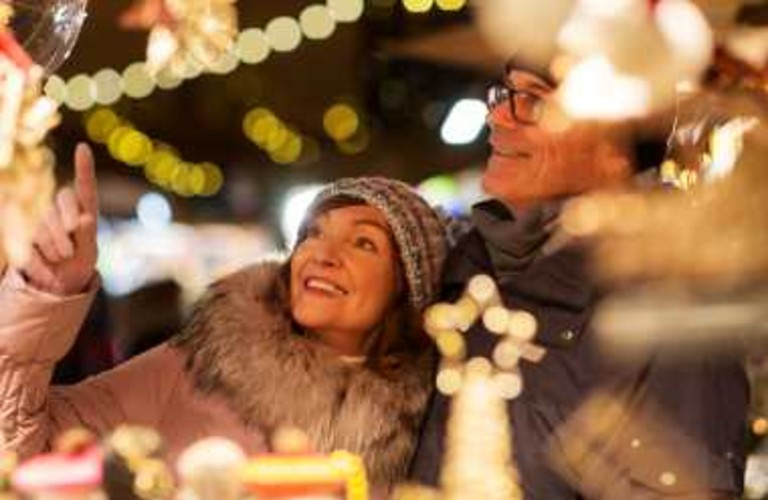 couple looking at lights