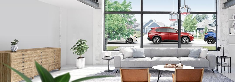 Nissan SUVs outside a home