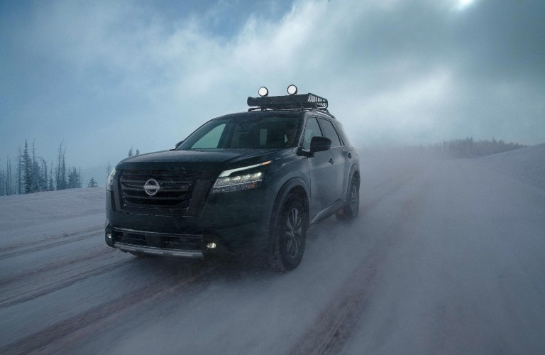 2022 Nissan Pathfinder driving through the snow