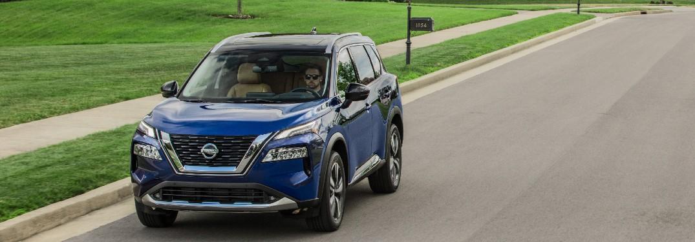 2021 Nissan Rogue driving through neighborhood